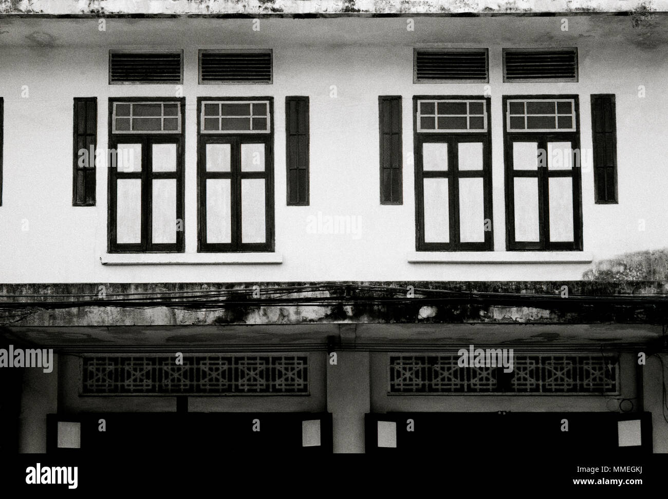 Chinese shophouse building in Bangkok in Thailand in Southeast Asia Far East. Architecture Window Travel B&W - Stock Image