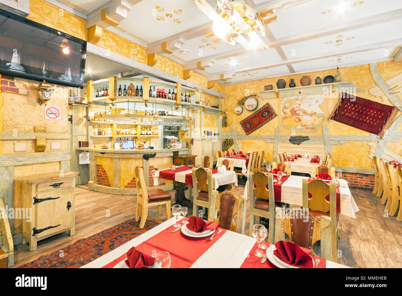 Moscow August 2014 Interior Of The Restaurant Rio Grande Hall Of Yellow Color Decorated In A Farmer S Style With Wooden Furniture Wooden Bar C Stock Photo Alamy