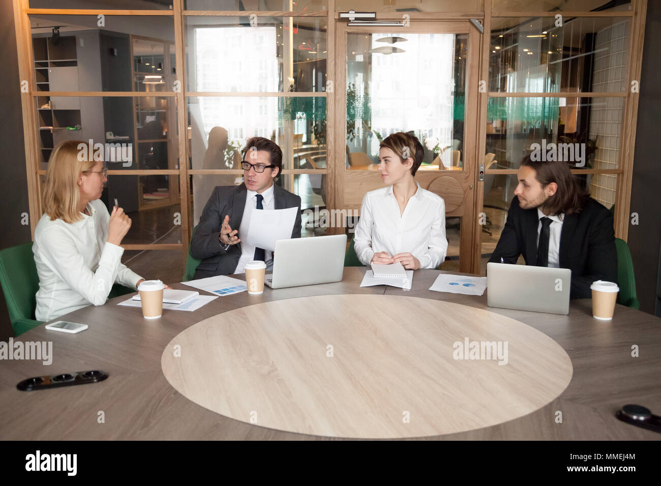 Business people discussing new design project at executive team  - Stock Image