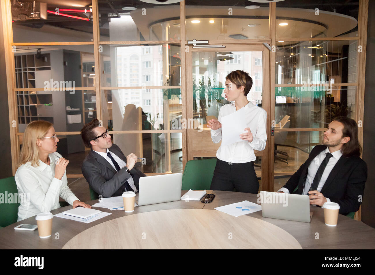 Businesswoman presenting document or speaking about business res - Stock Image