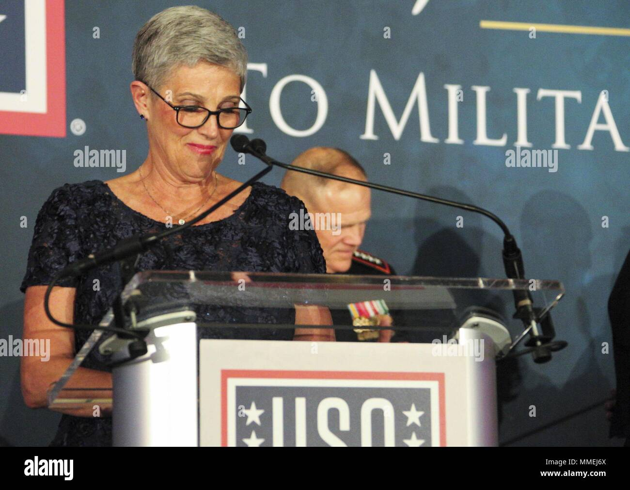 D'Arcy Neller, wife of Commandant of the Marine Corps Gen. Robert B. Neller, speaks to military members and guests during the 36th Annual USO Military Spouse Program Awards Dinner in Washington, D.C. May 10, 2018, May 10, 2018. The annual awards dinner honors military spouses. (U.S. Marine Corps photo by Sgt. Olivia G. Ortiz). () Stock Photo