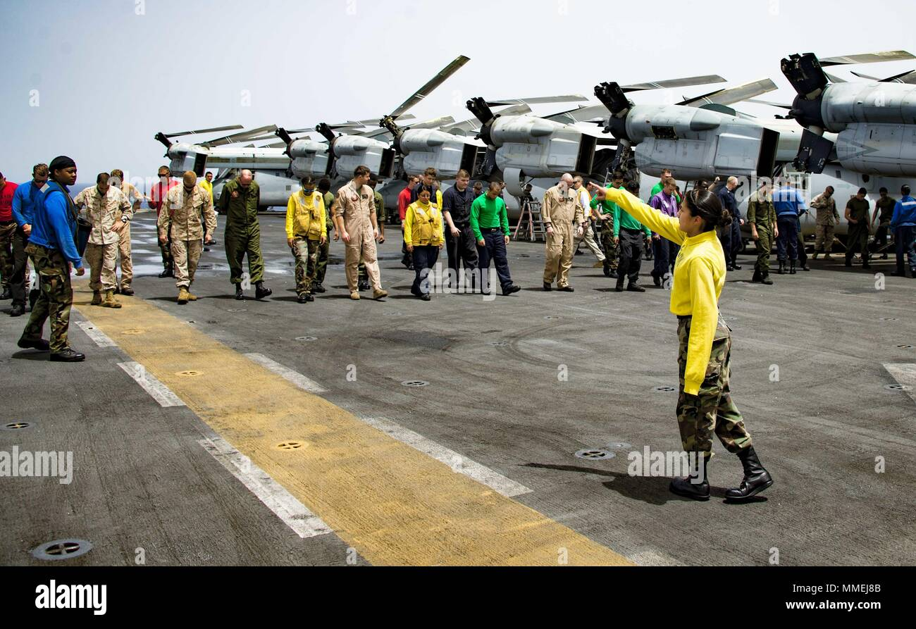 180510-N-ZK016-0020 U.S. 5TH FLEET AREA OF OPERATIONS (May 10, 2018) Sailors and Marines conduct a foreign object damage walk-down on the flight deck of the Wasp-class amphibious assault ship USS Iwo Jima (LHD 7), May 10, 2018, May 10, 2018. Iwo Jima, homeported in Mayport, Fla. is on deployment to the U.S. 5th Fleet area of operations in support of maritime security operations to reassure allies and partners, and preserve the freedom of navigation and the free flow of commerce in the region. (U.S. Navy photo by Mass Communication Specialist 3rd Class Joe J. Cardona Gonzalez /Released). () Stock Photo