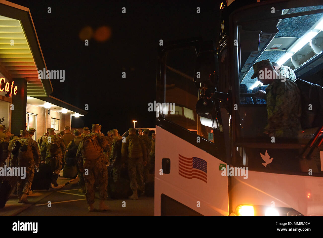 Members from Coast Guard Port Security Unit 309 disembark a bus at Mansfield Lahn Air National Guard Base in Mansfield, Ohio, Oct. 25, 2017. PSU 309 deployed to Guantanamo Bay, Cuba. (U.S. Coast Guard photo by Petty Officer 2nd Class Lauren Steenson). Stock Photo