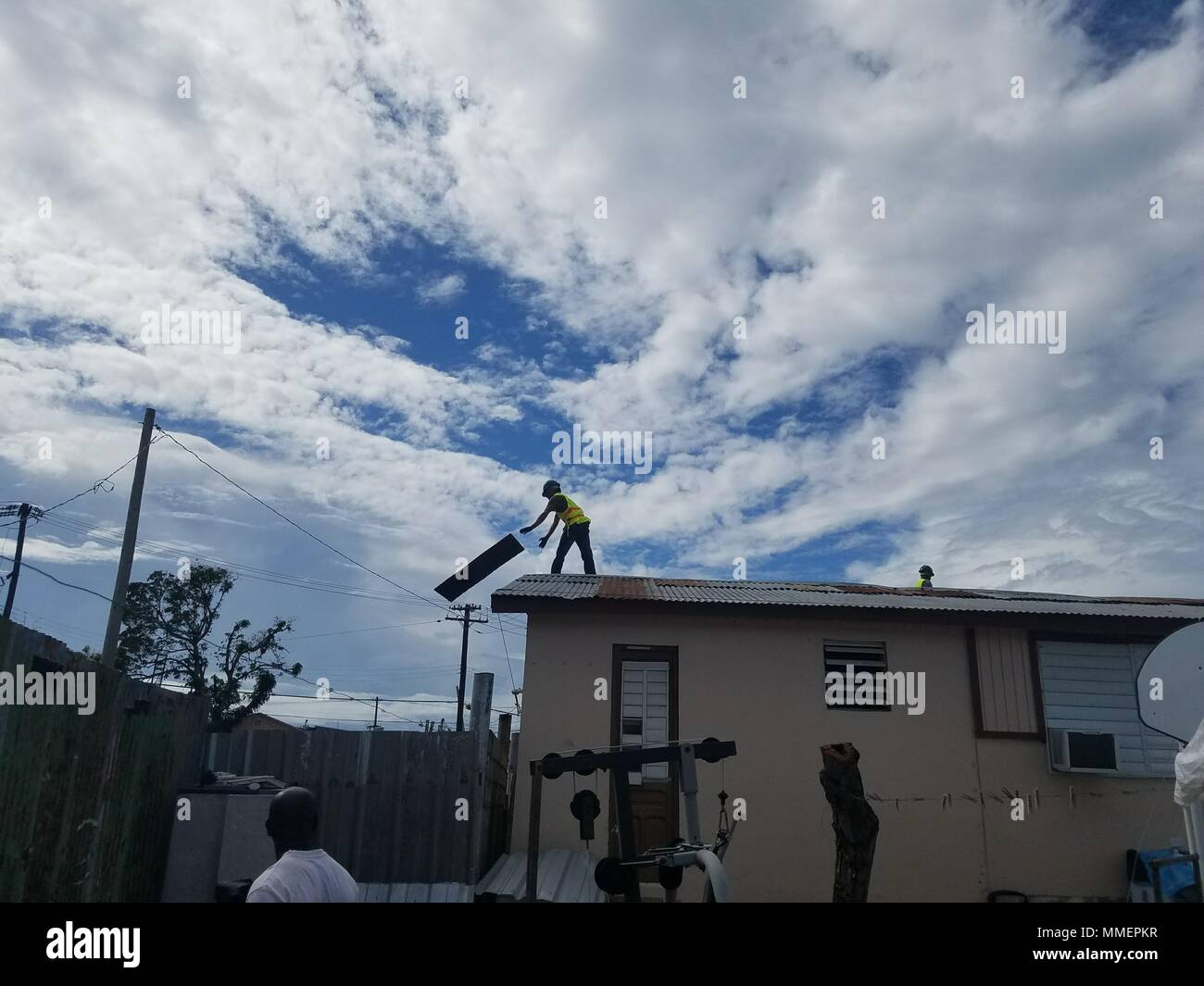 Ponce Puerto Rico Noel Silva A Contractor Working For The U S Army Corps Of Engineers Removes A Damaged Section Of Roofing To Prepare The Structure For A Temporary Blue Roof In
