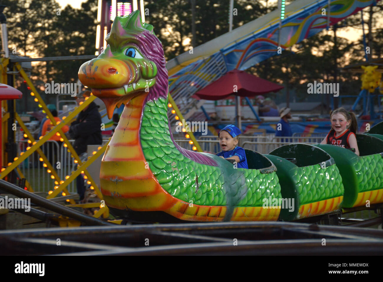 Catboy jason james and cheerleader marly ride a childrens dragon catboy jason james and cheerleader marly ride a childrens dragon roller coaster during fort stewarts fall fest oct 26 at donovan field freerunsca Gallery