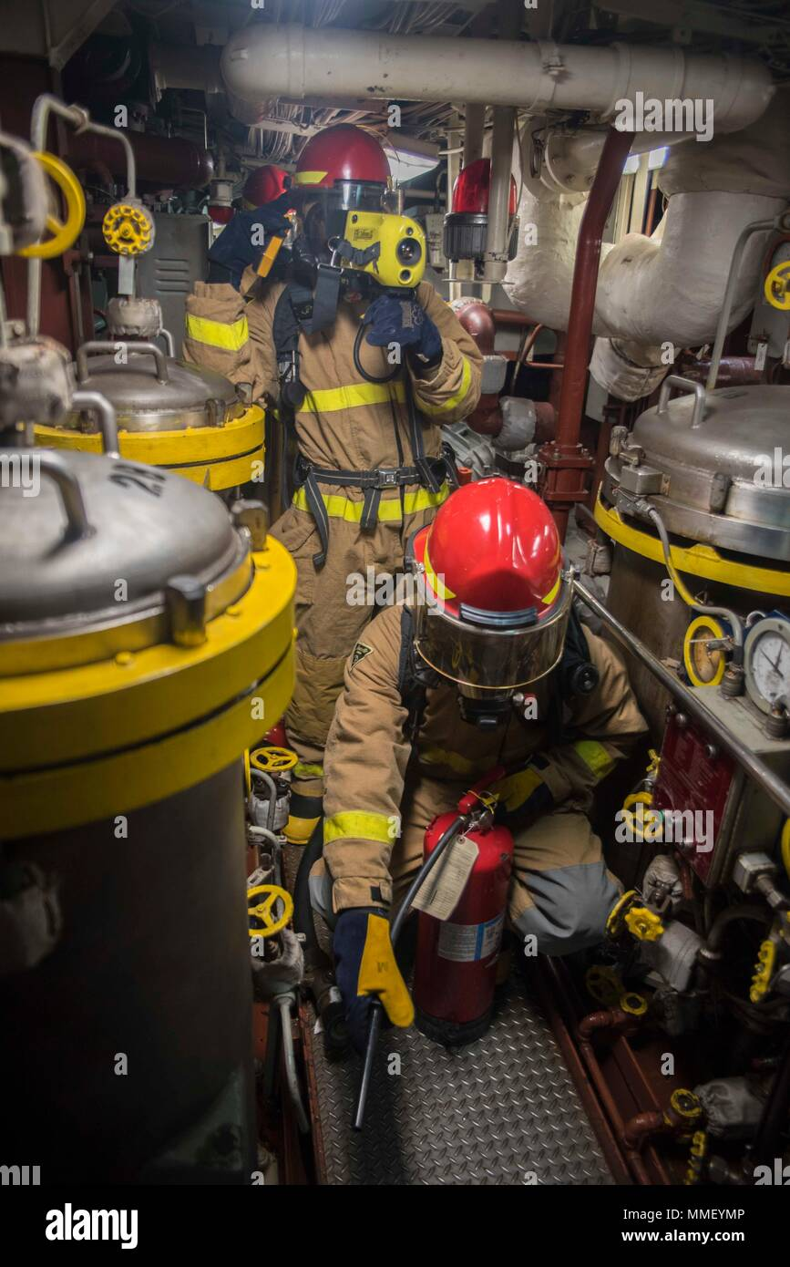 171031-N-DO281-117  ATLANTIC OCEAN (Oct. 31, 2017) Sailors respond to main engine room one during a main space fire drill aboard the guided-missile cruiser USS Monterey (CG 61). Monterey is deployed in support of maritime security operations in the U.S. 5th and 6th Fleet area of operations (U.S. Navy photo by Mass Communication Specialist Seaman Trey Fowler/Released) Stock Photo