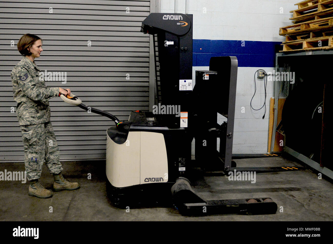 Staff Sgt. Destine White, 55th Logistics Readiness Squadron NCO in charge of equipment accounts, operates a forklift in the Bennie L. Davis Maintenance Facility Warehouse Monday, Oct. 16, 2017, on Offutt Air Force Base, Nebraska. Members of the logistics unit must undergo special training to operate machinery such as the forklift. (U.S. Air Force photo by Tech. Sgt. Rachelle Blake) - Stock Image