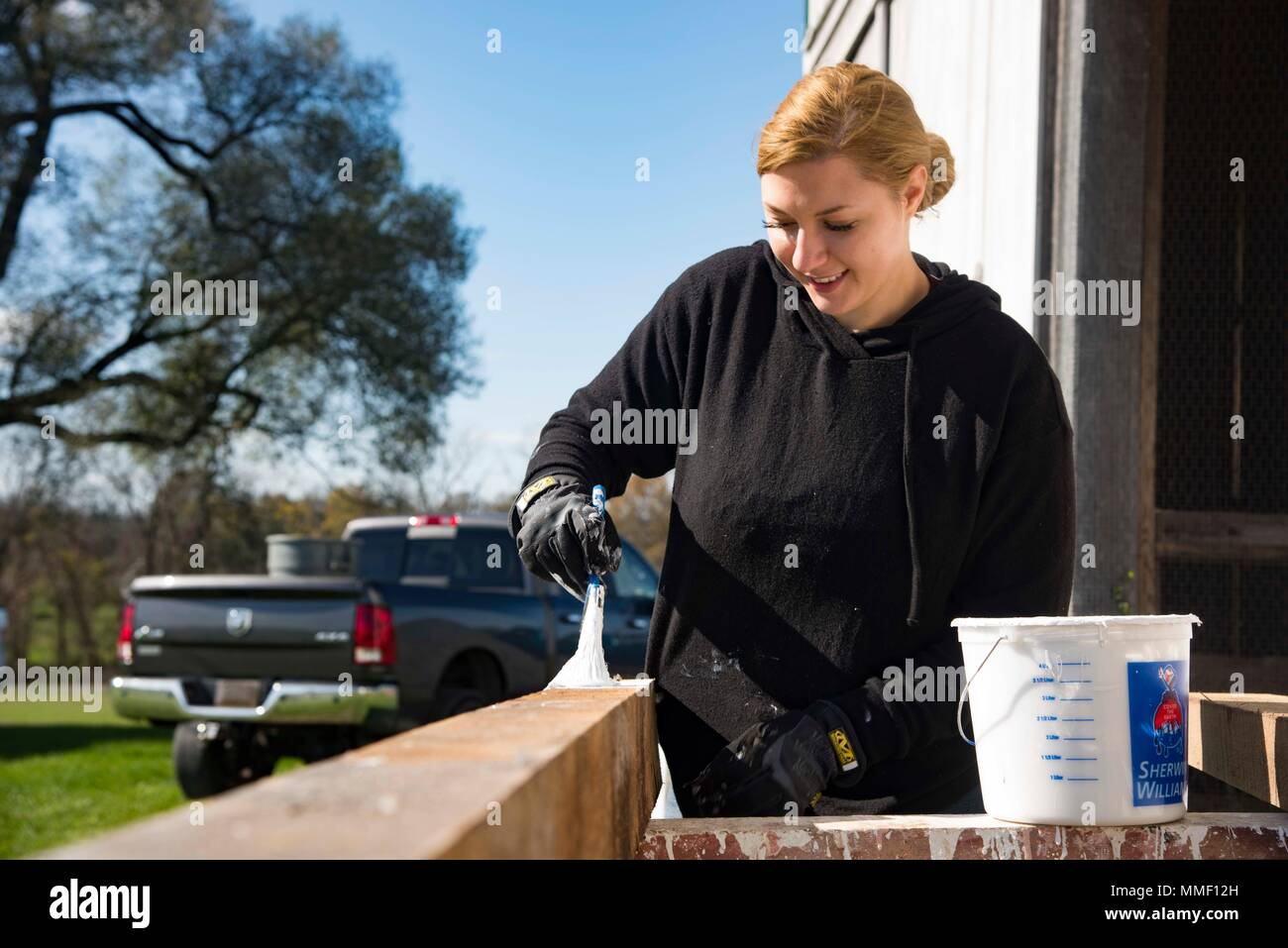 171031-N-FG807-189   GETTYSBURG, Pa. (Oct. 31, 2017) Quartermaster 3rd Class Taylor Miller, from Ravenna, Ohio, assigned to the aircraft carrier USS Dwight D. Eisenhower (CVN 69)(Ike), paints a fence post on the Dwight D. Eisenhower National Historic Site. Ike is undergoing a Planned Incremental Availability (PIA) at Norfolk Naval Shipyard during the maintenance phase of the Optimized Fleet Response Plan (OFRP).  (U.S. Navy photo by Mass Communication Specialist 3rd Class Devin Alexondra Lowe) Stock Photo