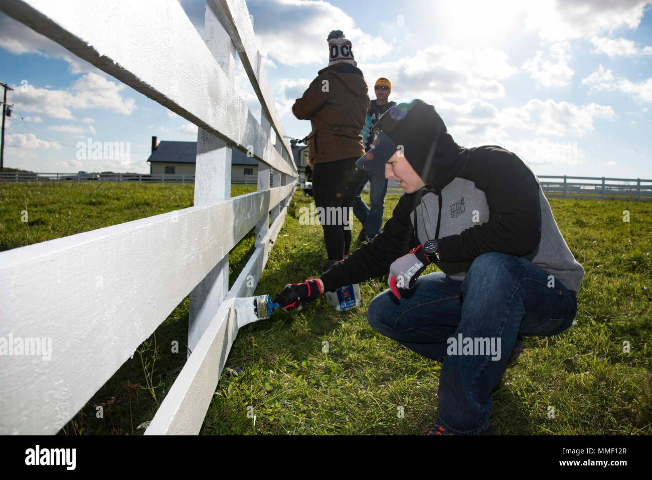 171031-N-FG807-167   GETTYSBURG, Pa. (Oct. 31, 2017) Information Systems Technician 2nd Class Brittany Hansen, from Scranton, Pa., assigned to the aircraft carrier USS Dwight D. Eisenhower (CVN 69)(Ike), paints a fence on the Dwight D. Eisenhower National Historic Site. Ike is undergoing a Planned Incremental Availability (PIA) at Norfolk Naval Shipyard during the maintenance phase of the Optimized Fleet Response Plan (OFRP).  (U.S. Navy photo by Mass Communication Specialist 3rd Class Devin Alexondra Lowe) Stock Photo
