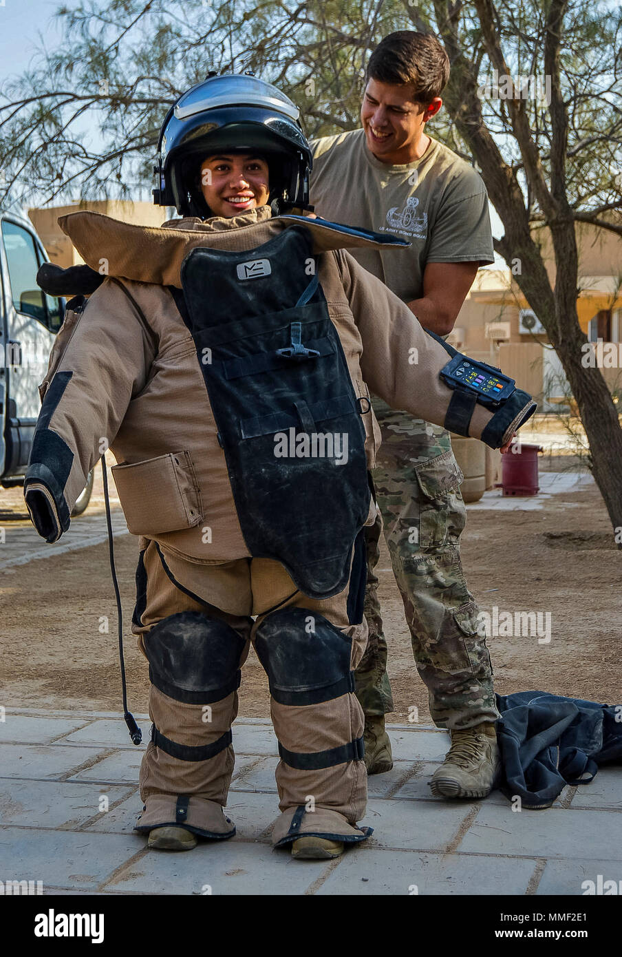 Spc Angela Lechuga A U S Army Reserve Soldiers From The 341st Military Police Company Of Mountain View California Tries On A Bomb Suit During Training On Explosive Ordnance Disposal Conducted By The