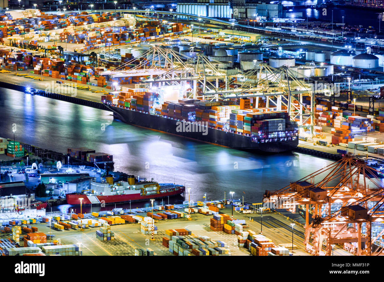Aerial view of a cargo ship loaded in the Seattle harbor container terminal - Stock Image