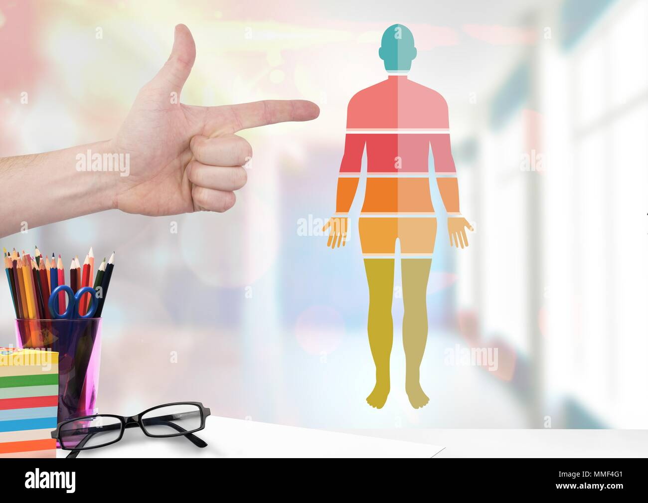 Human Body sections and hand pointing - Stock Image