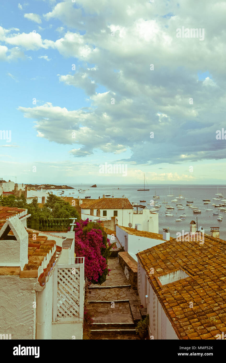 Panoramic view of the Spanish town of Cadaques,the famous small village of Costa Brava, Catalonia - Spain. Image with vintage and yesteryear effect - Stock Image