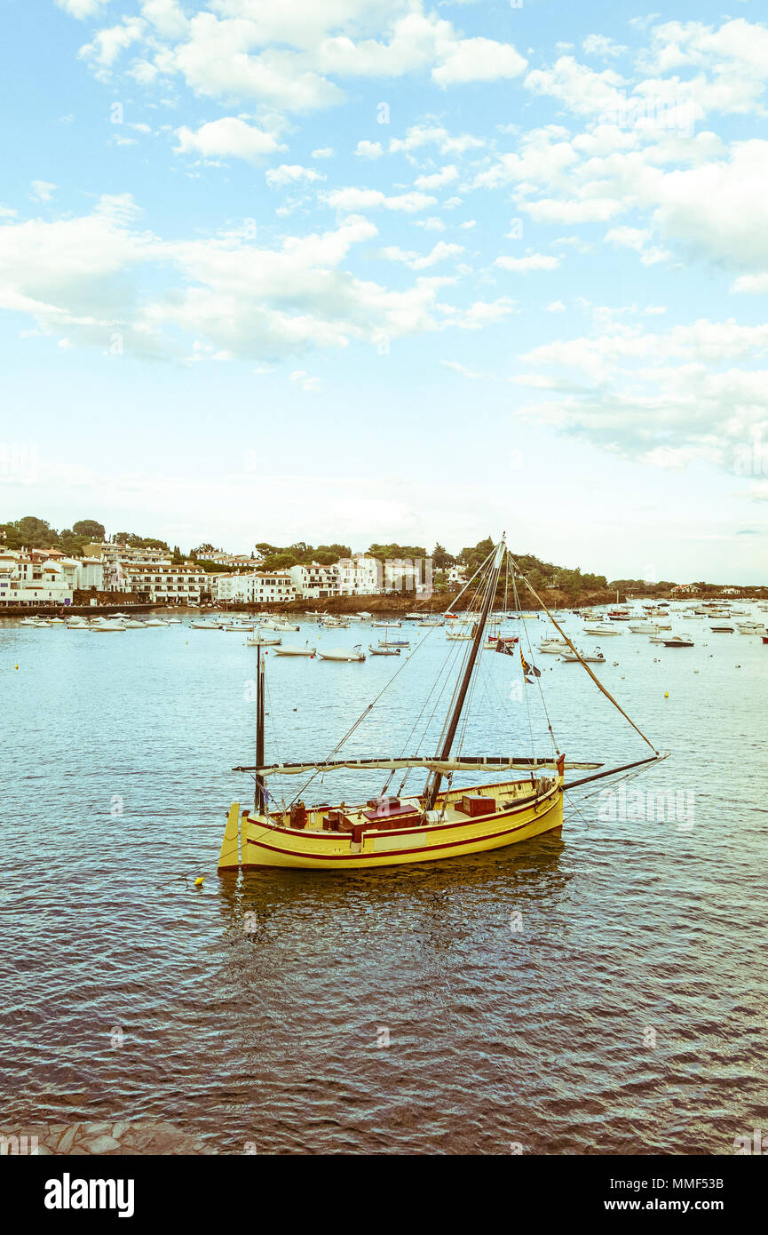 Tourist boat in the port of Cadaques, Costa Brava, province Girona, Catalonia, SpainImage with vintage and yesteryear effect - Stock Image