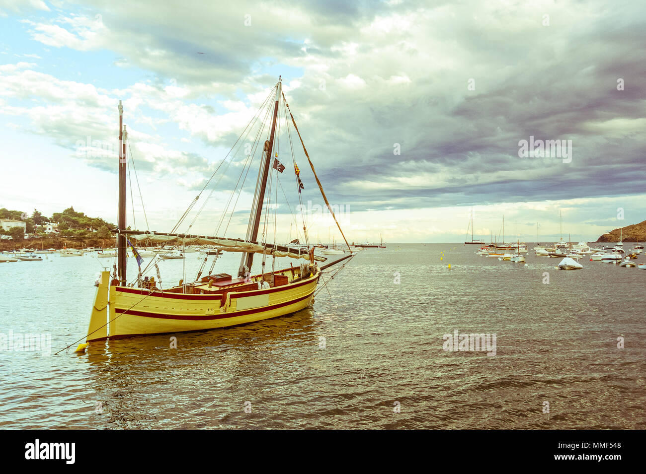 Tourist boat in the port of Cadaques, Costa Brava, province Girona, Catalonia, Spain. Image with vintage and yesteryear effect - Stock Image