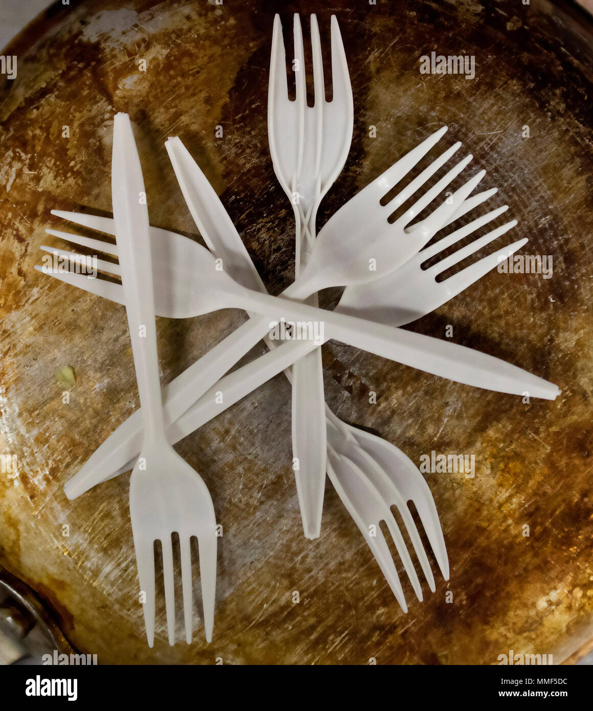 Artistic Arrangement of plastic forks on a rusted metal surface still life - Stock Image