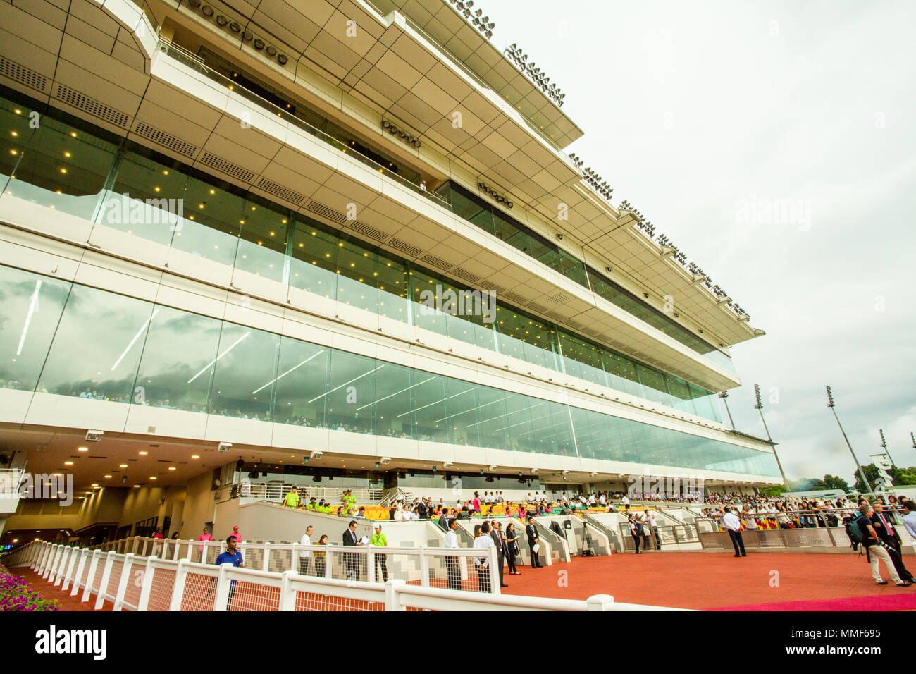 Singapore/Singapore - November 16, 2014: The Longines Gold Cup racing at the Kranji circuit in Singapore. The grandstand. Stock Photo