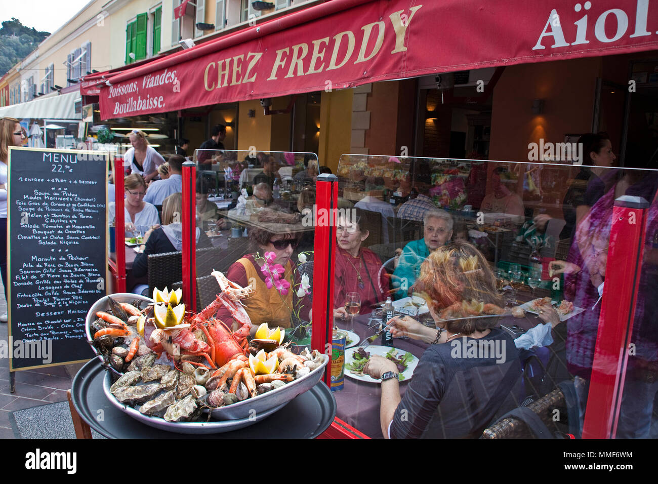 Street restaurant 'Chez Freddy' at place Cours Saleya, Nice, Côte d'Azur, Alpes-Maritimes, South France, France, Europe - Stock Image