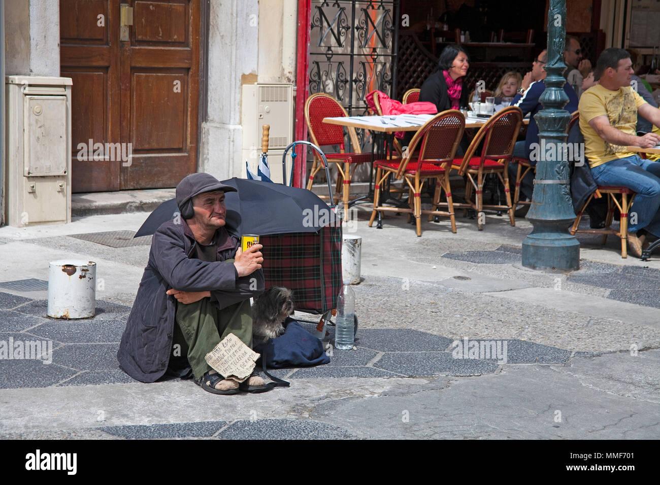 Beggar at a street cafe Nice, Côte d'Azur, Alpes-Maritimes, South France, France, Europe - Stock Image