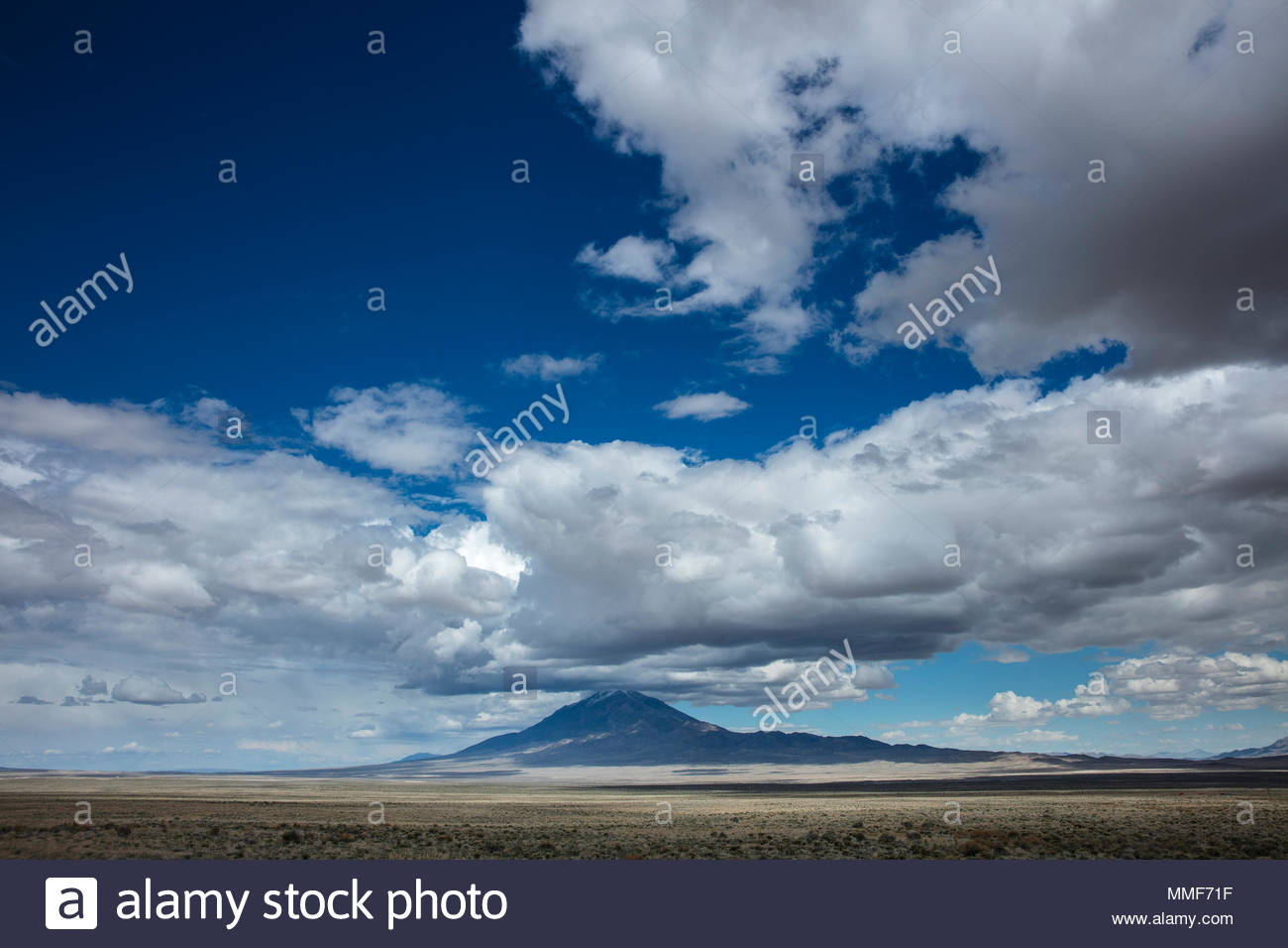 Clouds and big sky in the mountain landscape of the west . - Stock Image