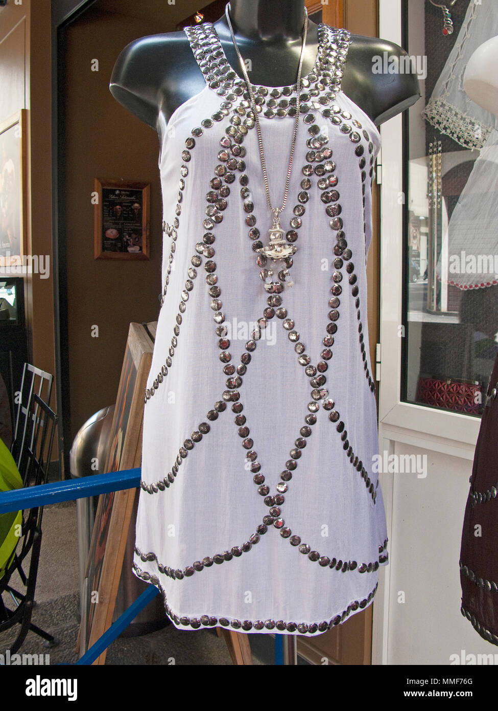 Rhinestone dress in a fashion shop in a shopping street close Place Masséna, Nice, South France, Alpes-Maritimes, Cote Azur, France, Europe - Stock Image
