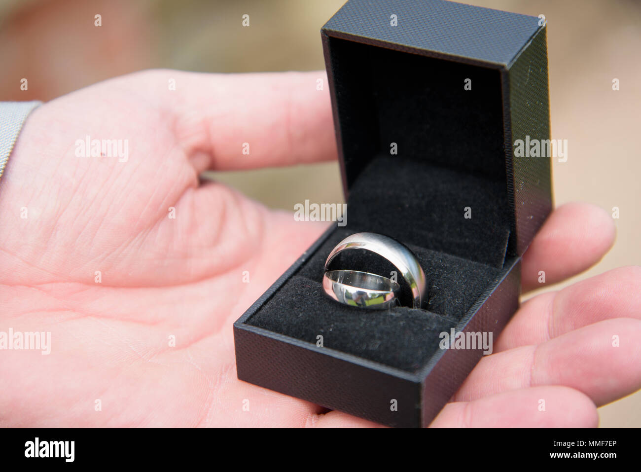 Hand Holding Box Of Wedding Rings Stock Photos & Hand Holding Box Of ...