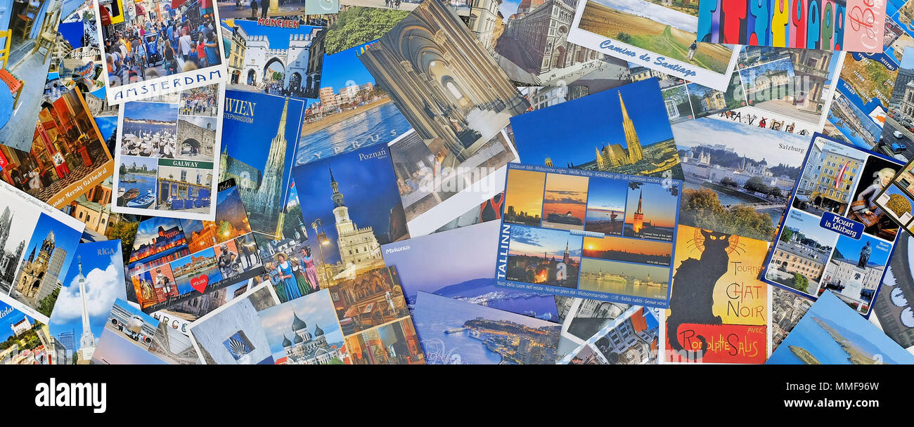 Pile of scattered postcards representing countreis throughout Europe. - Stock Image