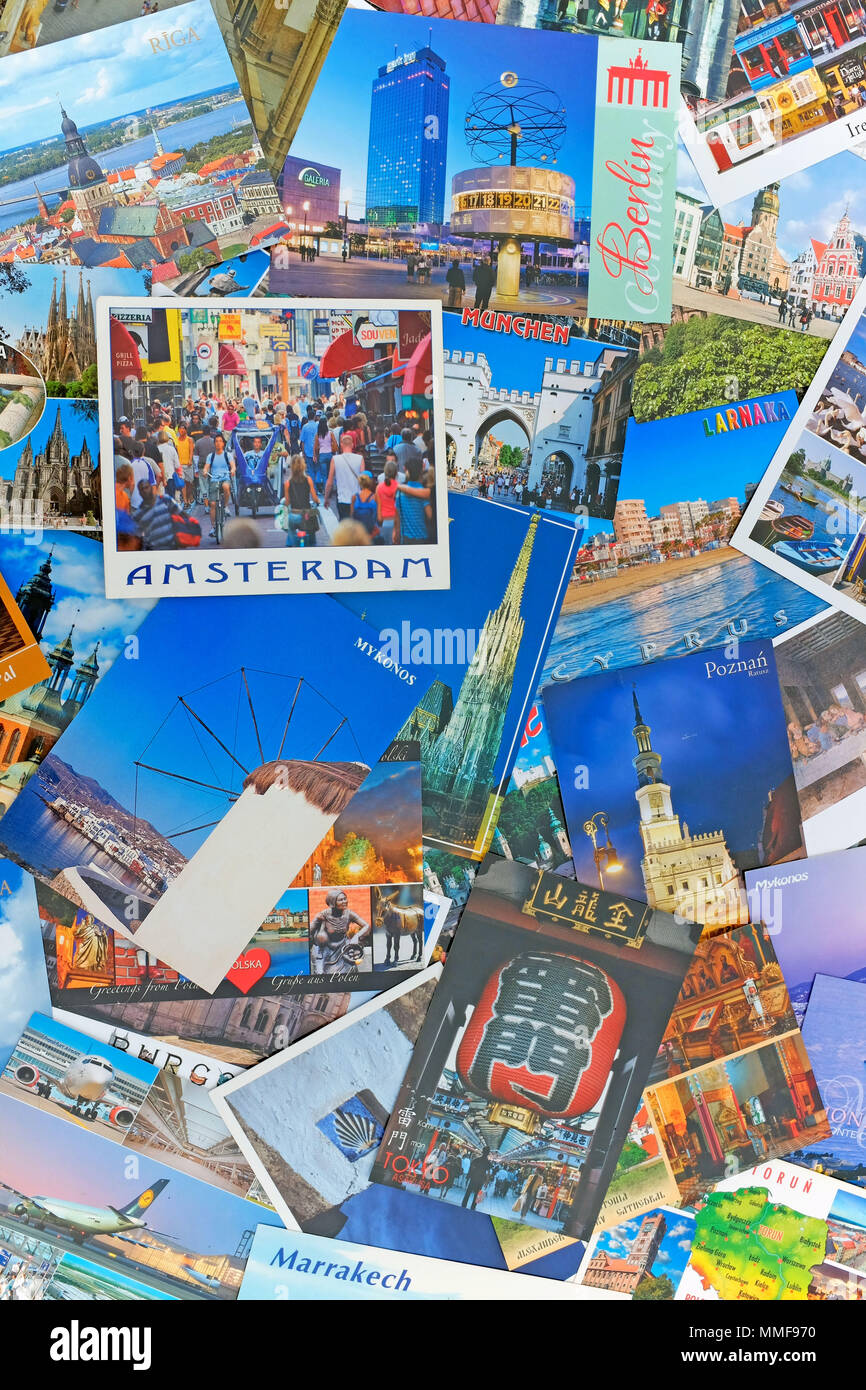 Souvenir postcards from throughout the world. - Stock Image