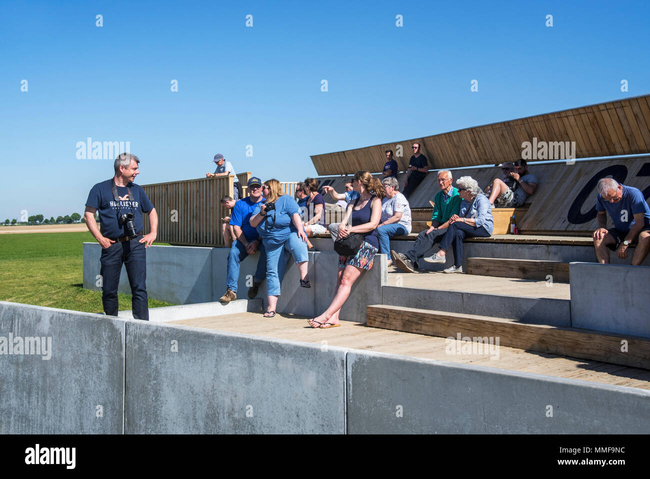 Plane spotters on aircraft spotting platform waiting for airplanes taking off from runway at Brussels Airport, Zaventem, Belgium - Stock Image