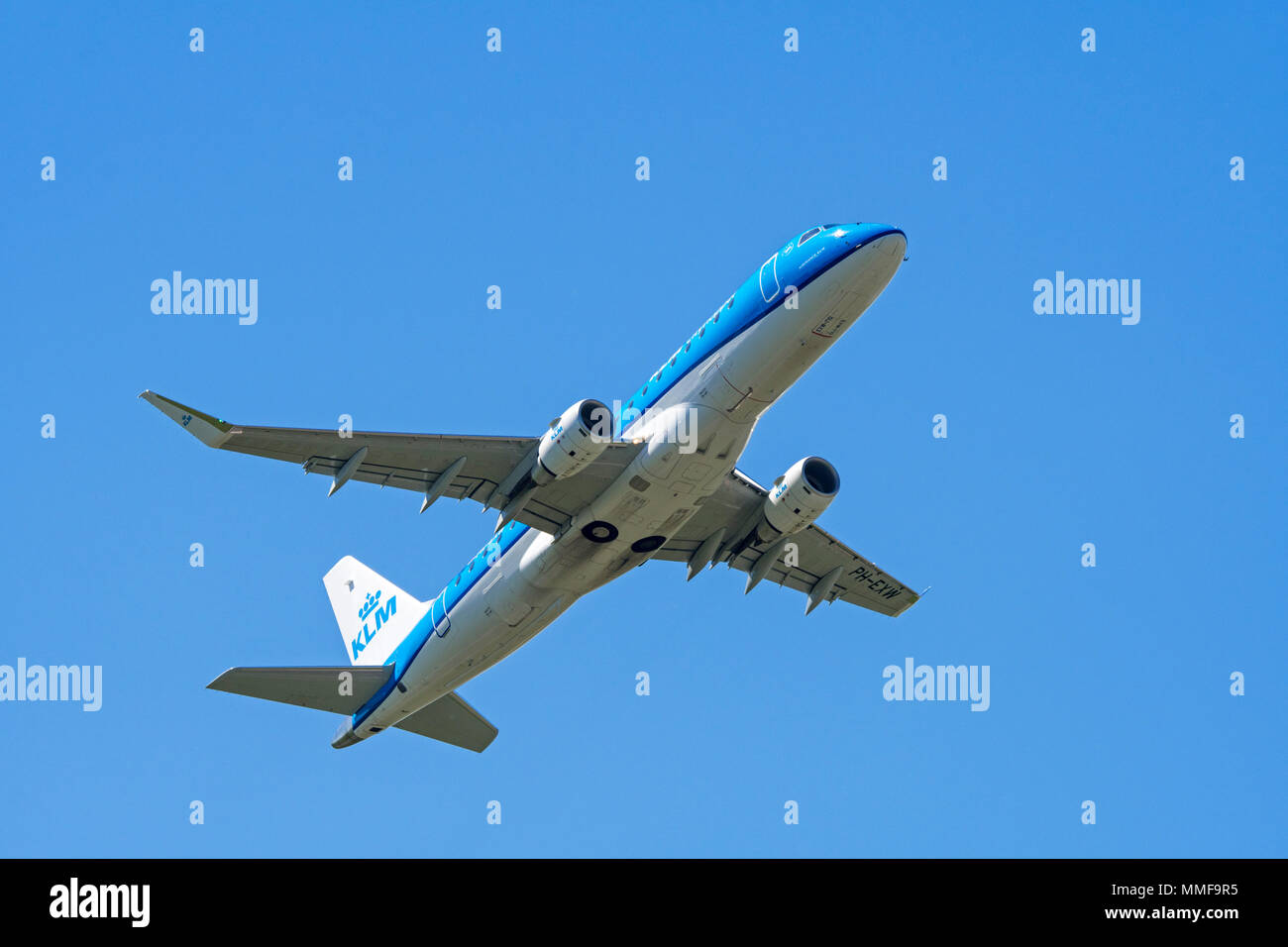KLM Cityhopper Embraer 175, medium-range twin-engine jet airliner in flight - Stock Image