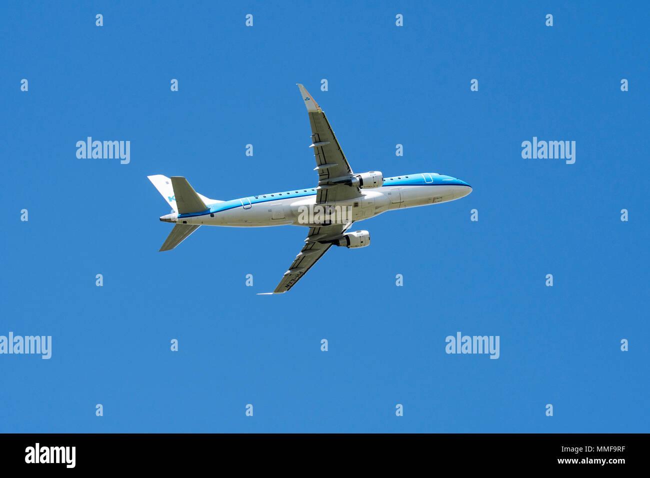 KLM Cityhopper Embraer 175, medium-range twin-engine jet airliner in flight - Stock Image