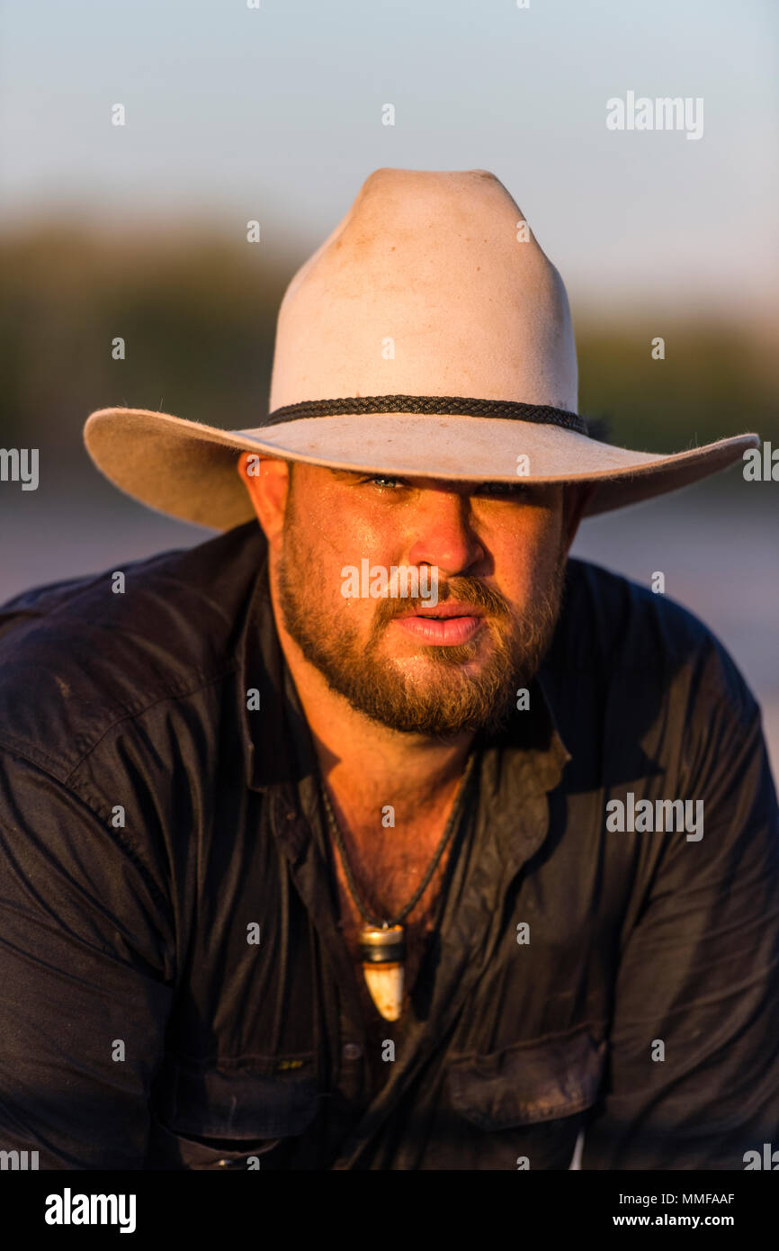 A portrait of a Saltwater Crocodile trapper wearing an Akubra hat on a  outback cattle station 47f2af3c59bd