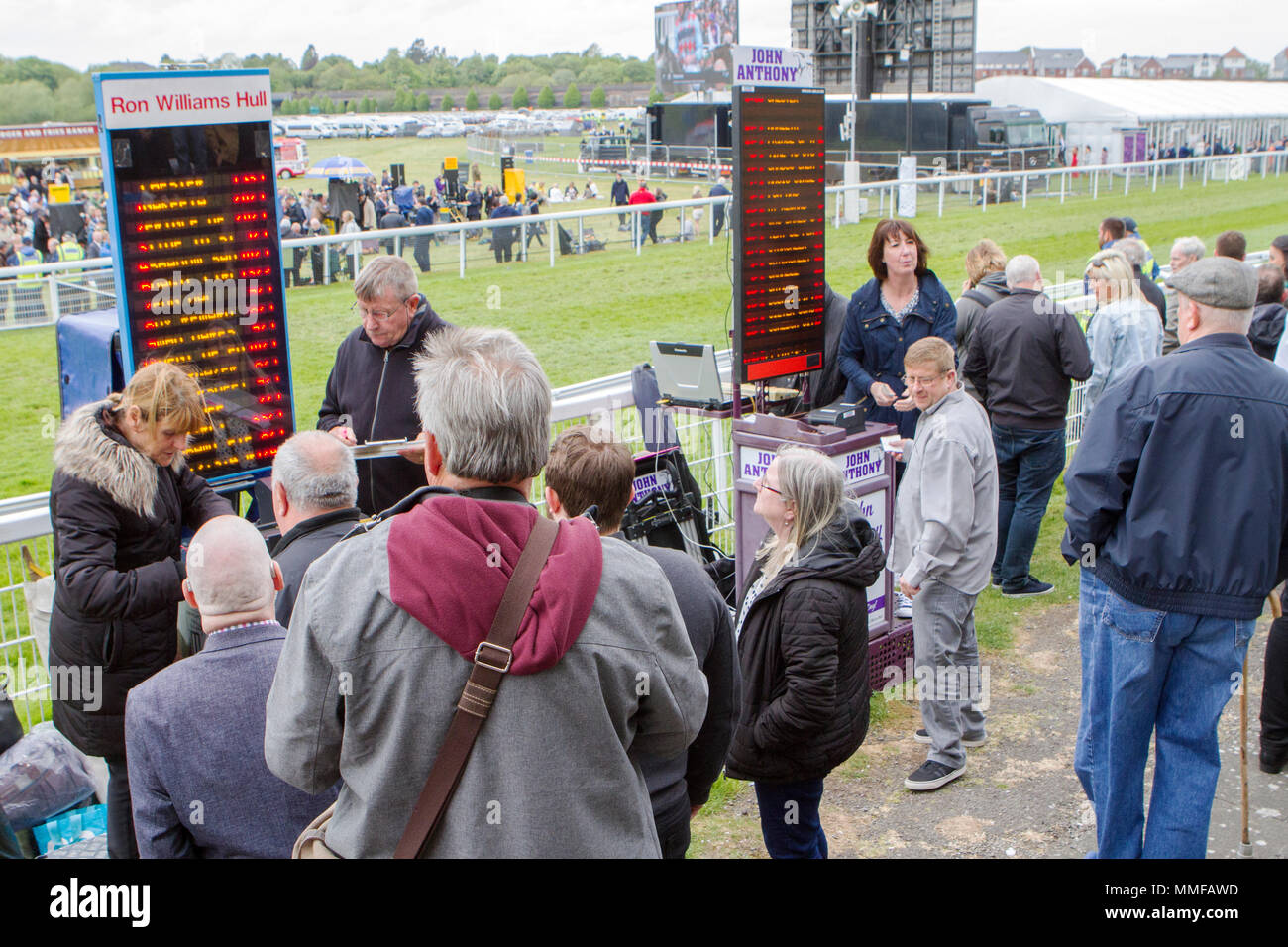 Bookmakers on their pitch at Chester races in Chester city centre, UK. - Stock Image
