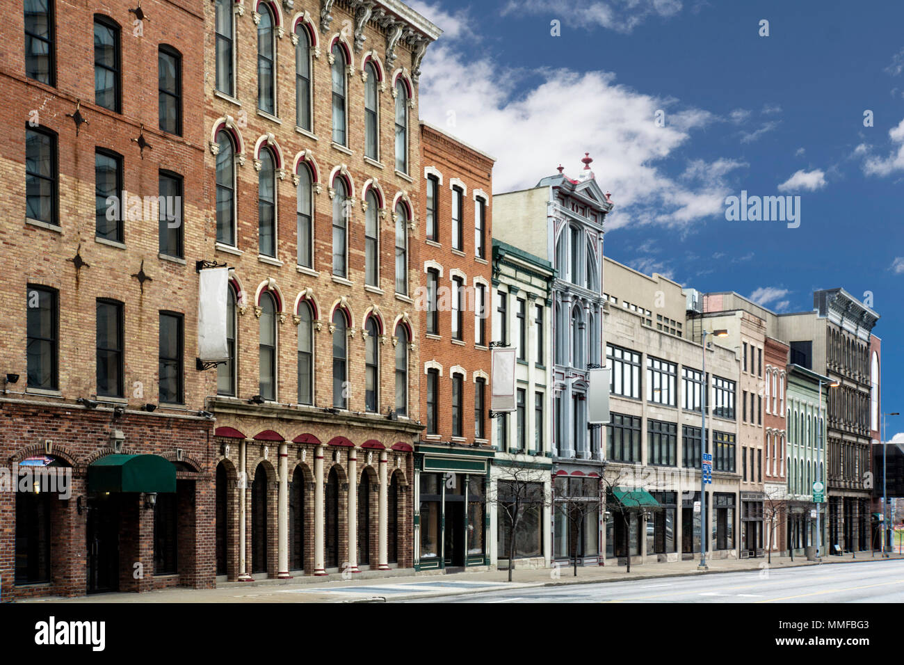 A photo of a typical small town main street in the United States of America. Features old brick buildings with specialty shops and restaurants. Stock Photo