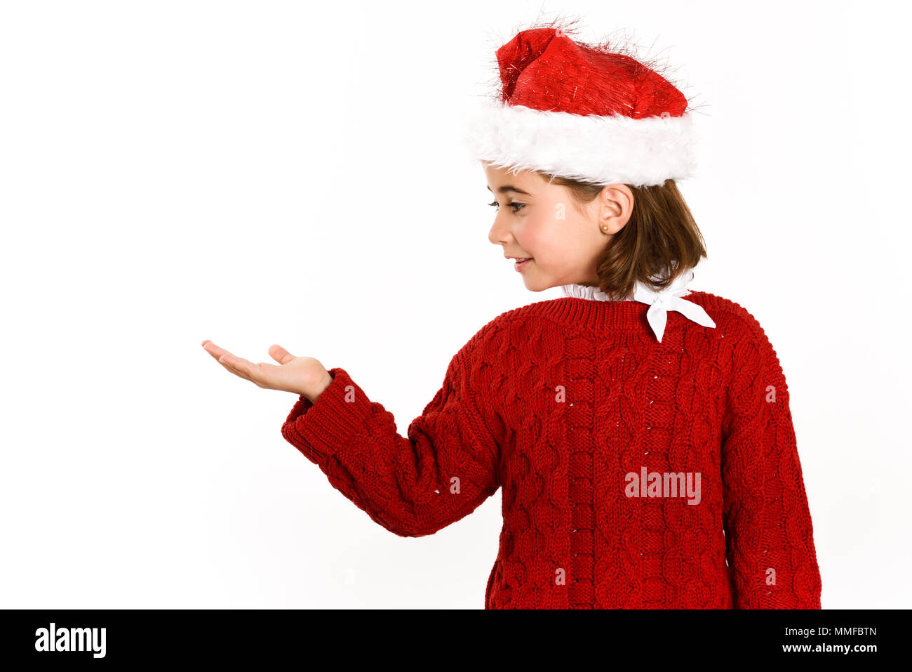 2798ff20b Adorable little girl wearing santa hat isolated on white background ...