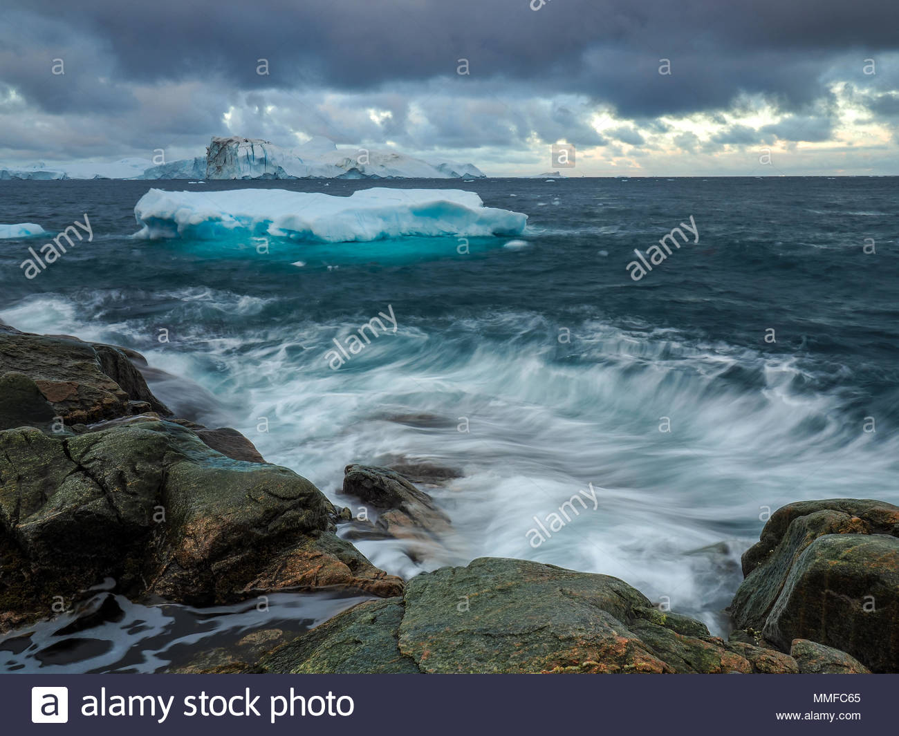 Iceberg floating on the ocean during windy weather. Icefiord UNESCO Herritage Site. - Stock Image