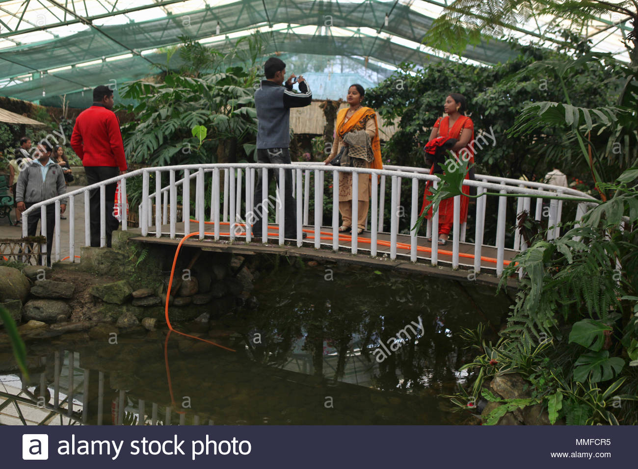 Indian tourists at the Flower Exhibition Center in Gangtok Sikkim. Sikkim is famous for flowers especially orchids and the Flower Exhibition is very p - Stock Image