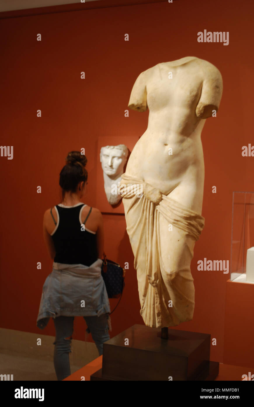 Girl watching at famous sculptures of Venus and David  Scene