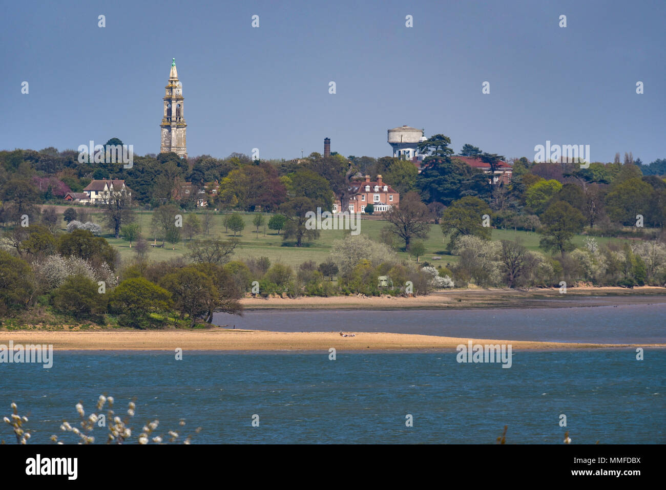 Royal Hospital School Holbrook tower, Suffolk, UK. River Stour, river, beaches. Countryside on sunny day. Shotley peninsula. Blue sky. Space for copy - Stock Image