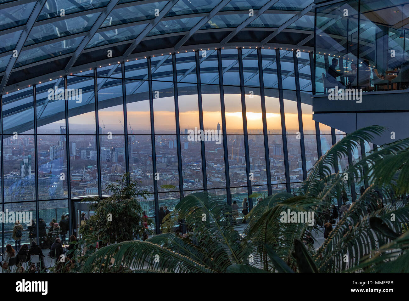The Sky Garden at sunset at the top of the 20 Fenchurch Street skyscraper (the Walkie-Talkie building), London, England, UK. - Stock Image