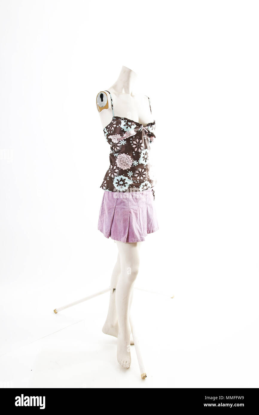 Dark top and purple mini skirt summer spring wear on mannequin full body shop display. Woman fashion styles, clothes on white studio background. - Stock Image