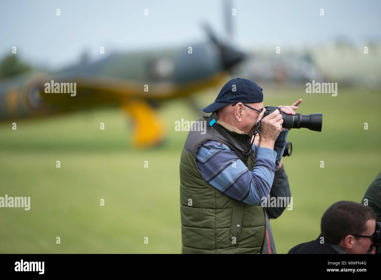 IWM Duxford, Cambridgeshire, UK. 11 May, 2018. Entry level photographers and enthusiasts get to grips with aviation photography on the Airfield at IWM Duxford complete with classic British fighter aircraft for Best of British day. Credit: Malcolm Park/Alamy Live News. - Stock Image