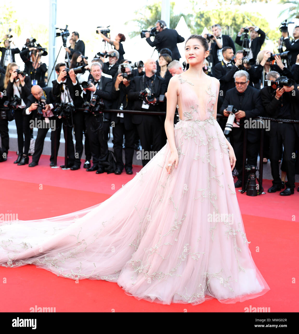 """Cannes, France. 11th May, 2018. Chinese actress Guan Xiaotong poses on the red carpet before the premiere of the film """"Ash Is Purest White"""" at the 71st Cannes Film Festival in Cannes, France, on May 11, 2018. The 71st Cannes Film Festival is held here from May 8 to May 19. Credit: Luo Huanhuan/Xinhua/Alamy Live News Stock Photo"""