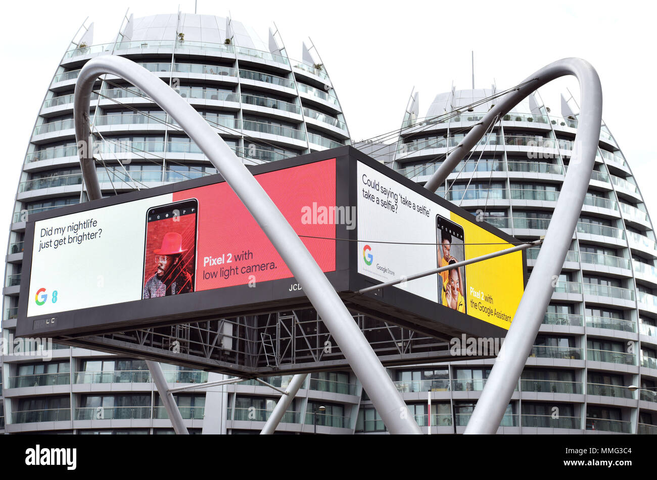 Digital advertising hoardings promoting Google Store and mobile phone EE Pixel 2 on the Old Street Roundabout in East London, UK. - Stock Image