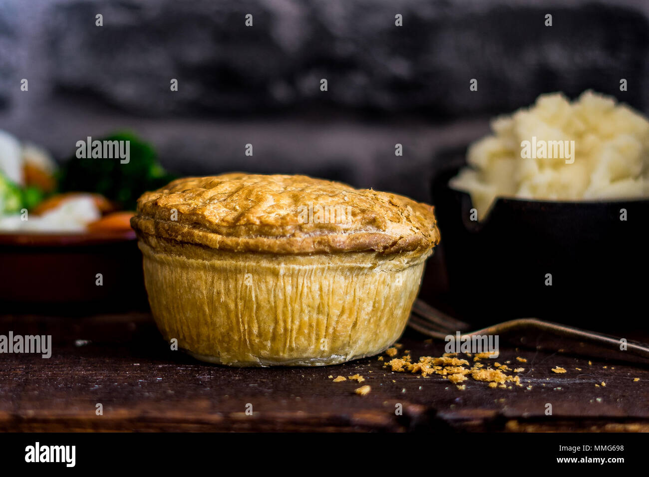 Generic Pie with mash and vegetables - Stock Image