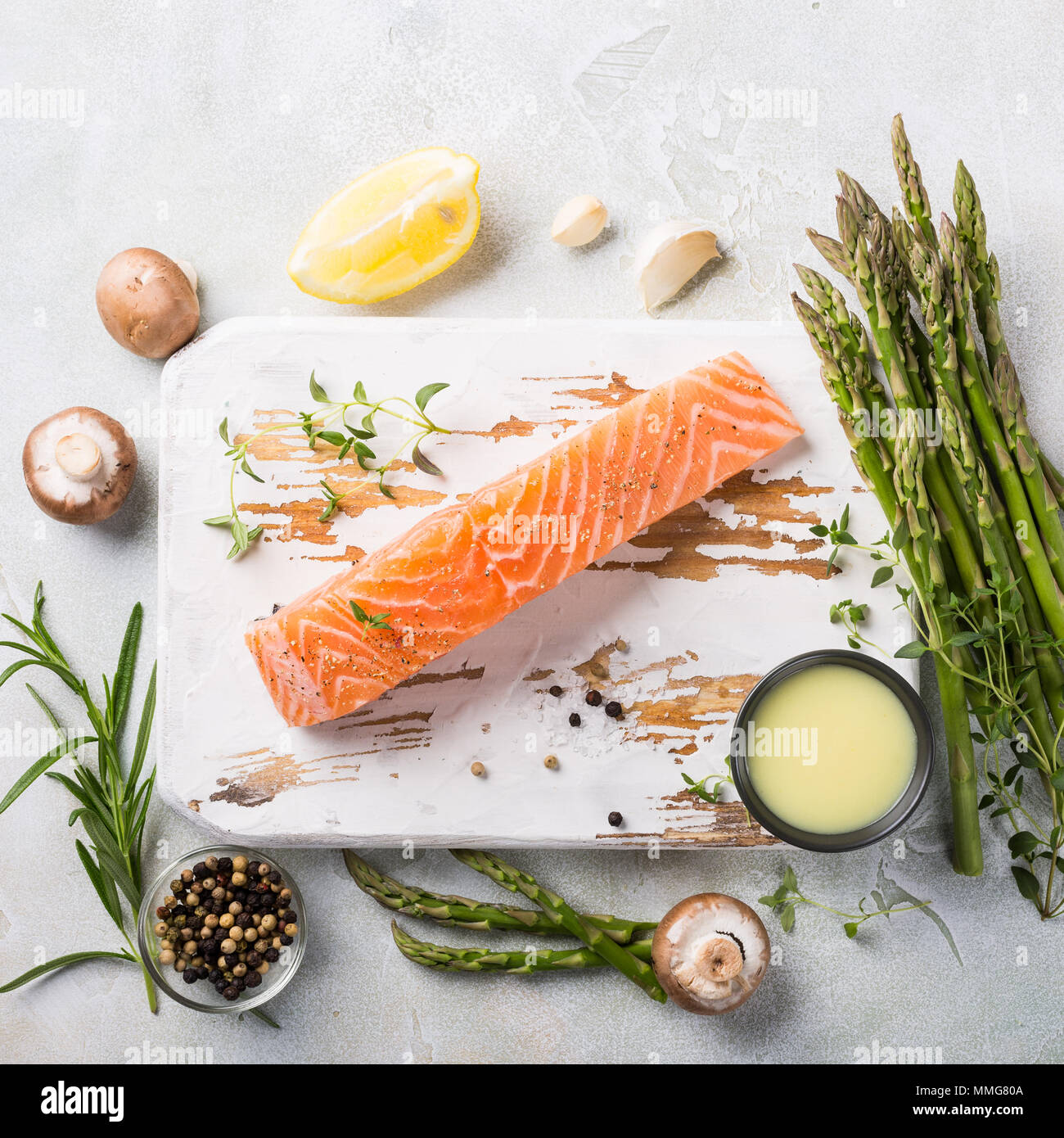 fresh green asparagus and raw salmon fillet - Stock Image