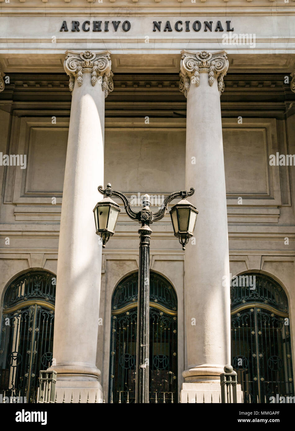 Front of the collonaded National Archive building of the National Library with old fashioned streetlights, Santiago, Chile, South America Stock Photo
