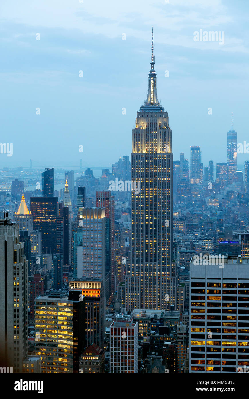 The Empire State Building and New York skyline in the evening seen from the Top of the Rock, New York city United States of America - Stock Image