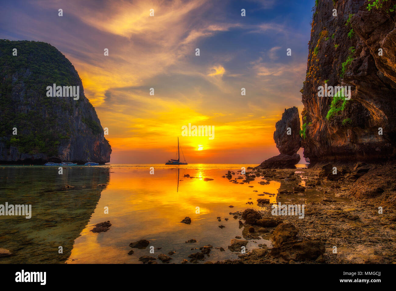 Sunset at the Maya beach on Koh Phi Phi island in Thailand - Stock Image