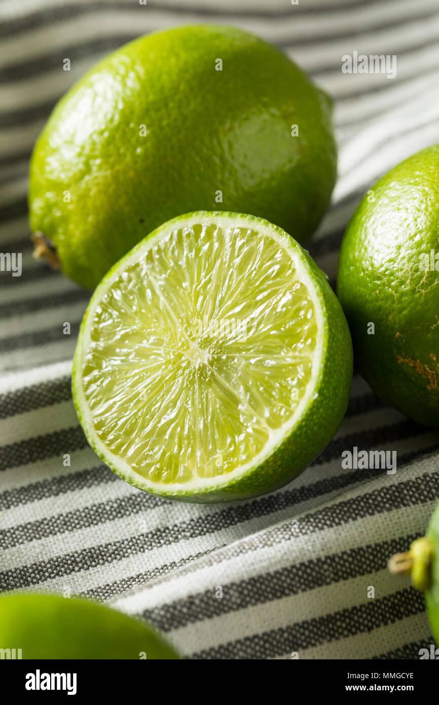 Raw Green Organic Citrus Limes Cut in Half Stock Photo
